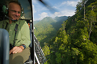 Aerial view of the Foja Mountains rain forest.  Researcher Bruce Beehler on a helicoptor survey searching for possible landing sites.  Beehler was the main force behind biological exploration of the Foja Mountains on these expeditions.