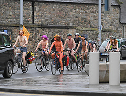 Naked cyclists took to the streets of Edinburgh as part of Naked Cycle Week. They cycled thru the city, including riding past the Scottish Parliament.<br /> <br /> © Dave Johnston/ EEm