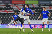 Cardiff City forward Kieffer Moore (10) is challenged by Curtis Davis of Derby County (33) during the EFL Sky Bet Championship match between Derby County and Cardiff City at the Pride Park, Derby, England on 28 October 2020.