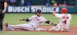 May 20, 2017 - St Louis, MO, USA - St. Louis Cardinals' Yadier Molina is tagged out by San Francisco Giants shortstop Brandon Crawford while trying to steal second in the second inning during a game between the St. Louis Cardinals and the San Francisco Giants on Saturday, May 20, 2017, at Busch Stadium in St. Louis. (Credit Image: © Chris Lee/TNS via ZUMA Wire)