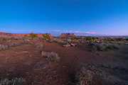 The sunset view looking eastward from Murphy Hogback, along the White Rim Road, Island in the Sky District, Canyonlands National Park, Moab, Utah, USA.