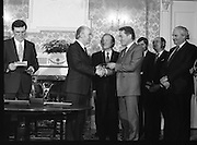 New Fianna Fáil Administration Sworn In.  (R52)..1987..10.03.1987..03.10.1987..10th March 1987..After their win in the recent general election the new Fianna Fáil government,under the leadershio of Charles Haughey, was sworn in and given their seals of offce at a ceremony in Áras an Uachtaráin today. The government received their seals from President Patrick Hillery...Photograph shows President Hillery presenting the seal of office to Dr Rory O'Hanlon at the ceremony in the Arás