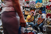 Two youth sell clothes at an informal market in Ciudad Nezahualcoyotl, March 14, 2011.