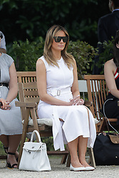 U.S. First Lady Melania Trump look at Basque dancers in the garden of the Villa Arnaga, House-museum of Edmond Rostand, during a visit on traditional Basque culture in Combo-les-Bains, near Biarritz as part of the G7 summit, August 25, 2019. Photo by Thibaud Moritz/ABACAPRESS.COM