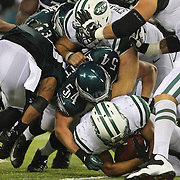 Jets Kahlil Bell is tackled during the New York Jets V Philadelphia Eagles Pre Season NFL match at MetLife Stadium, East Rutherford, NJ, USA. 29th August 2013. Photo Tim Clayton