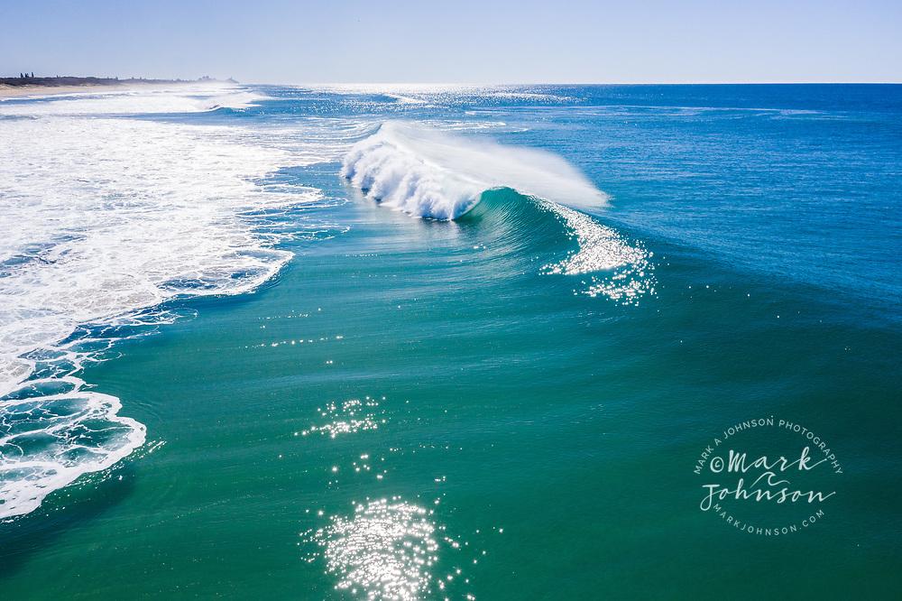Aerial view of a breaking wave, Bokarina, Sunshine Coast, Queensland, Australia