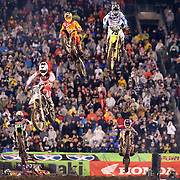 Mike Alessi, (bottom left), Suzuki, Joshua Hill, (top right) in action during the final of the 450SX Class Championship during round 16 of the Monster Energy AMA Supercross series held at MetLife Stadium. 62,217 fans attended the event held for the first time at MetLife Stadium, New Jersey, USA. 26th April 2014. Photo Tim Clayton
