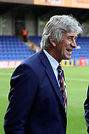 West Ham United manager Manuel Pellegrini smiling before kick off during the EFL Carabao Cup 2nd round match between AFC Wimbledon and West Ham United at the Cherry Red Records Stadium, Kingston, England on 28 August 2018.