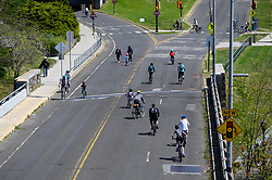 Cyclist and pedestrians are seen on East River Drive, with the Center City Philadelphia, PA skyline in the background on April 28, 2020. Despite the state-wide stay-at-home order still in effect, spring weather draws hundreds to exercise outdoors.