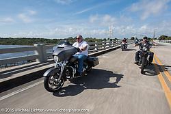 Joe Panzica rides his Harley-Davidson dresser through Tamoka State Park during Daytona Beach Bike Week  2015. FL, USA. Friday, March 13, 2015.  Photography ©2015 Michael Lichter.