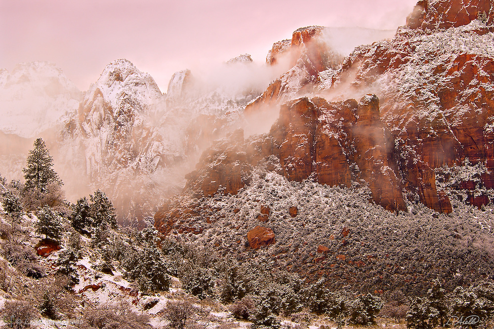 Clouds shroud the cliffs and peaks between West Temple and the Altar of Sacrifice in Zion National Park after a winter snowstorm.
