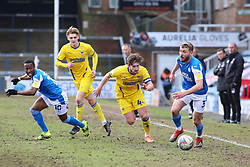 Dan Butler of Peterborough United in action with Alex Woodyard of AFC Wimbledon - Mandatory by-line: Joe Dent/JMP - 20/02/2021 - FOOTBALL - Weston Homes Stadium - Peterborough, England - Peterborough United v AFC Wimbledon - Sky Bet League One