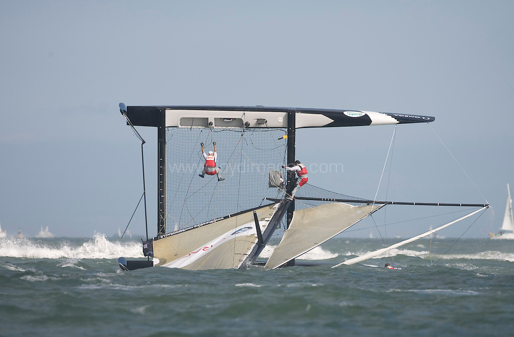 """Day two of Skandia Cowes Week 2008..Pictures iShares Cup Extreme 40 racing.  Picture showes """"BMW ORACLE Racing - Spithill""""   skippered by James Spithill (AUS) mid capsize as a gust hits the fleet....Please credit all pictures """"Lloyd Images"""""""
