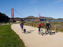 California, San Francisco: Bicyclists and dog walker at Crissy Field near the Golden Gate Bridge.Photo #:  1-casanf76363.Photo © Lee Foster 2008