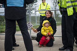 © Licensed to London News Pictures. 11/10/2017. Lancashire, UK.  A protester and her child at the Anti-Fracking Demonstration in Kirby Misperton, Yorkshire. The protest blocked the entrance to Third Energy's Hydraulic fracking site after they were granted permission to set up their drilling rig at the site.  Photo credit: Steven Speed/LNP
