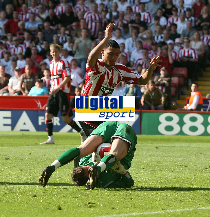 Photo: Mark Stephenson.<br /> Sheffield United v Watford. The Barclays Premiership. 28/04/2007.Watford's keeper Ben Foster makes a good save from Sheffield's Colin Kazim-Richards