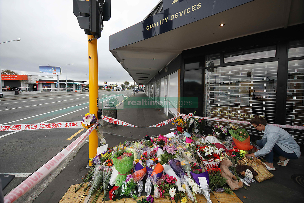 March 17, 2019 - Christchurch, New Zealand - A woman places flowers to victims of the mosque attacks outside the Linwood Masjid mosque in Christchurch on March 16, 2019. At least 49 people dead and more than 40 people injured following attacks on two mosques in  Christchurch. The national security threat level has been increased from low to high for the first time in New Zealand's history after this attack. (Credit Image: © Sanka Vidanagama/NurPhoto via ZUMA Press)