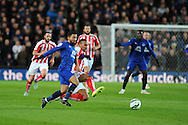 Aaron Lennon of Everton is tackled by Stoke city's Steven Nzonzi.   Barclays Premier League match, Stoke city v Everton at the Britannia Stadium in Stoke on Trent , Staffs on Wed 4th March 2015.<br /> pic by Andrew Orchard, Andrew Orchard sports photography.
