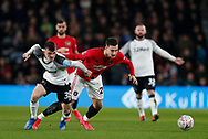 Jason Knight of Derby County challenges Diogo Dalot of Manchester United during the FA Cup match at the Pride Park Stadium, Derby. Picture date: 5th March 2020. Picture credit should read: Darren Staples/Sportimage