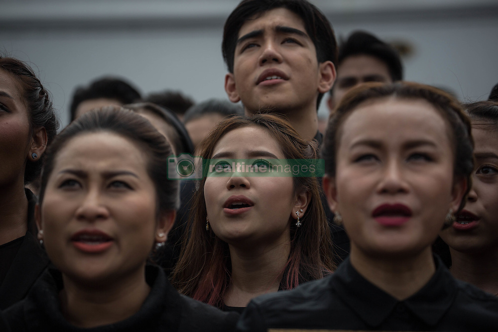 October 22, 2016 - Bangkok, Bangkok, Thailand - Mourners dressed in black perform the Royal Anthem at Sanam Luang front of the Grand Palace in Bangkok, Thailand on October 22, 2016. More than 100.000 mourners from across Thailand came during the long week end holiday to sing the Thai Royal Anthem to pay respect to the late Thailand King Bhumibol Adulyadej who passed away on October 13, 2016 at Siriraj Hospital. Thai King Bhumibol Adulyadej was the world's longest reigning monarch and died at the age of 88 after a long illness since several years, he was the most unifying symbol for Thai people and leaving behind him a divided country under military control. (Credit Image: © Guillaume Payen/NurPhoto via ZUMA Press)