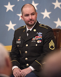 October 1, 2018 - Washington, District of Columbia, U.S. - United States President Donald J. Trump awards the Medal of Honor to Ronald J. Shurer II, for conspicuous gallantry for actions he took in support of Operation Enduring Freedom on April 6, 2008 as a Staff Sergeant in the United States Army in the East Room of the White House in Washington, DC on Monday, October 1, 2018  (Credit Image: © Ron Sachs/CNP via ZUMA Wire)