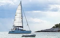 THEMENBILD - ein Segelboot mit Beiboot in der Adria, aufgenommen am 27. Juni 2018 in Pula, Kroatien // a sailing boat with dinghy in the Adriatic Sea, Pula, Croatia on 2018/06/27. EXPA Pictures © 2018, PhotoCredit: EXPA/ JFK