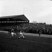 28/01/1962<br /> 01/28/1962<br /> 28 January 1962<br /> League of Ireland soccer: Cork Hibernians v Shelbourne at Tolka Park, Dublin.<br /> Shels P.Bonham (right) receives close attention from Hibs centre-forward, McElroy as he attempts a clearance.