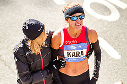 NYC Marathon, Mary Wittenberg consoles a tearful Kara Goucher, 36, USA, after she finishes a disappointing 14th