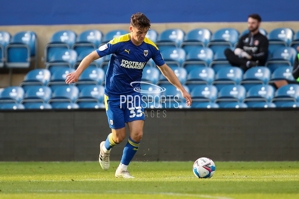 AFC Wimbledon midfielder Callum Reilly (33) dribbling during the EFL Trophy Group O match between AFC Wimbledon and Charlton Athletic at the Kiyan Prince Foundation Stadium, London, England on 1 September 2020.