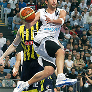 Efes Pilsen's Kerem TUNCERI during their Turkish Basketball Legague Play-Off semi final second match Efes Pilsen between Fenerbahce at the Sinan Erdem Arena in Istanbul Turkey on Friday 27 May 2011. Photo by TURKPIX