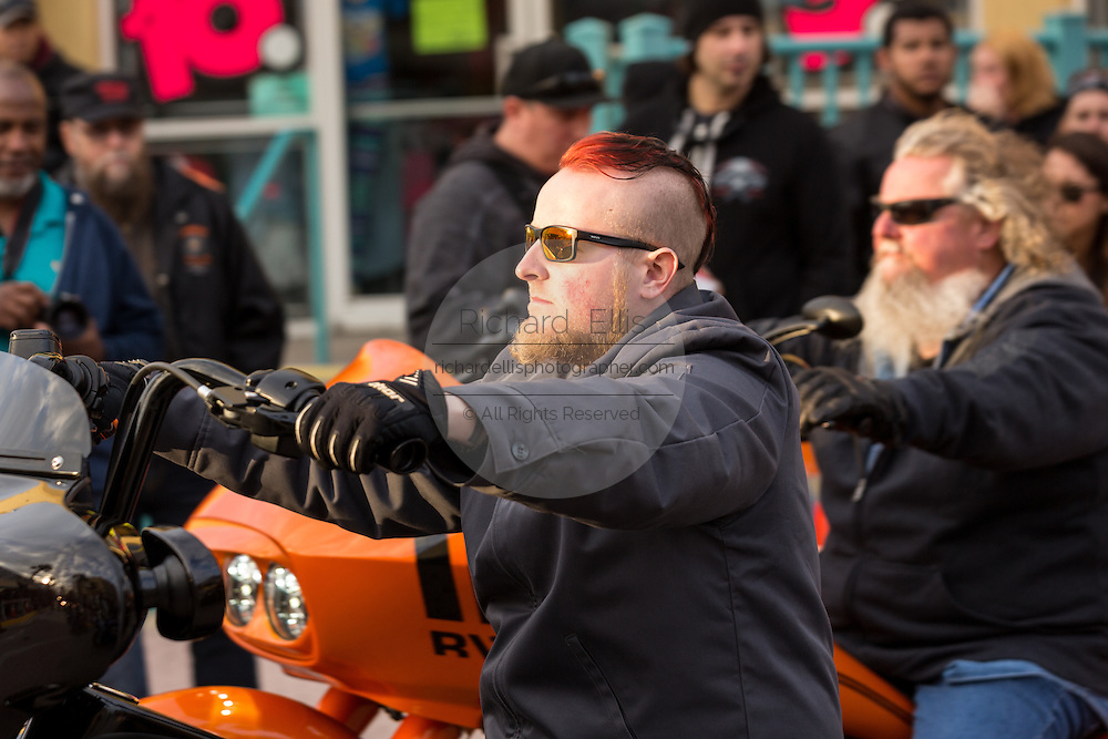 A biker with a mohawk haircut cruises down Main Street during the 74th Annual Daytona Bike Week March 7, 2015 in Daytona Beach, Florida.