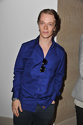 ALFIE ALLEN at a party to celebrate the launch of the Lucy in Disguise Ready to Wear collection exclusive to Harvey Nichols, held at The Fifth Floor Restaurant, Harvey Nichols, Knightsbridge, London on 25th May 2011.