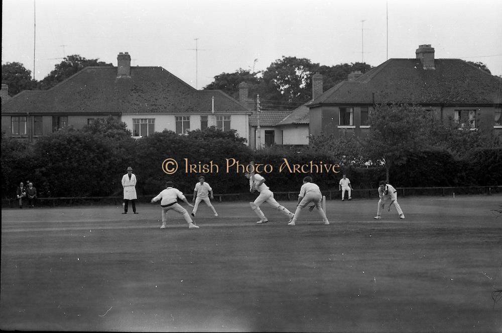 18/07/1970<br /> 07/18/1970<br /> 18 July 1970<br /> Cricket: Clontarf 1st XI v Old Belvedere, Leinster Senior Cup Final at Clontarf Cricket Club, Castle Avenue, Dublin. Clontarf players alert as Frank O'Hanlon (centre), Old Belvedere opening batsman hits a high ball that nobody caught.