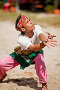 """Sept. 27, 2009 -- PATTANI, THAILAND: A Muslim man performs a traditional Pattani folk dance from the time of the Pattani Sultanate in the 1600's at a community festival in Pattani, Thailand.  Thailand's three southern most provinces; Yala, Pattani and Narathiwat are often called """"restive"""" and a decades long Muslim insurgency has gained traction recently. Nearly 4,000 people have been killed since 2004. The three southern provinces are under emergency control and there are more than 60,000 Thai military, police and paramilitary militia forces trying to keep the peace battling insurgents who favor car bombs and assassination.   Photo by Jack Kurtz / ZUMA Press"""