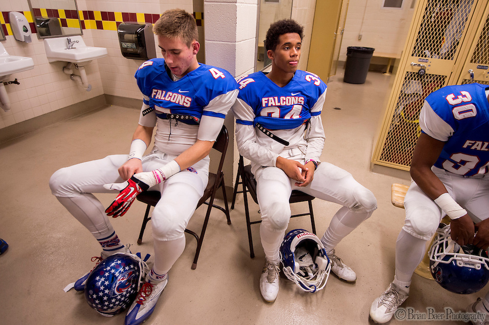Christian Brothers Falcons Spencer Webb (4), and Tyler Green (34), wait in the locker room before the Sac-Joaquin Section Division I football playoff game between the Christian Brothers Falcons and Cordova Lancers at Huges Stadium,  Friday Nov 11, 2016.<br /> photo by Brian Baer