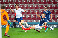 Harvey Barnes (#21) of England U21s (West Bromwich Albion, loan from Leicester City) crosses the ball during the U21 UEFA EUROPEAN CHAMPIONSHIPS match between Scotland and England at Tynecastle Stadium, Edinburgh, Scotland on 16 October 2018.