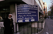 A Muslim gentleman stands outside the Met Police's Aliens Registration Office in Holborn where the languages of six foreign nations are written on its board, on 13th February 1987, in London, England.