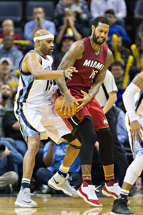 MEMPHIS, TN - NOVEMBER 25:  James Johnson #16 of the Miami Heat looses the ball while being defended by Vince Carter #15 of the Memphis Grizzlies at the FedExForum on November 25, 2016 in Memphis, Tennessee.  The Heat defeated the Grizzlies 90-81.  NOTE TO USER: User expressly acknowledges and agrees that, by downloading and or using this photograph, User is consenting to the terms and conditions of the Getty Images License Agreement.  (Photo by Wesley Hitt/Getty Images) *** Local Caption *** James Johnson; Vince Carter