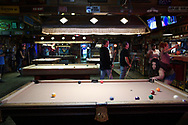 Patrons play pool at Sportstown Billiards, which is located in the area known as the Milk District in Orlando, Fla., Saturday, March 25, 2017. (Phelan M. Ebenhack via AP)