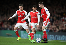 Arsenal's Alexis Sanchez (centre) with Aaron Ramsey (right) and Laurent Koscielny during the UEFA Champions League Round of 16, Second Leg match at the Emirates Stadium, London.