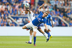 Steven Pienaar of Everton and Andy King of Leicester City collide in the compete in the air - Photo mandatory by-line: Rogan Thomson/JMP - Mobile: 07966 386802 16/08/2014 - SPORT - FOOTBALL - Leicester - King Power Stadium - Leicester City v Everton - Barclays Premier League