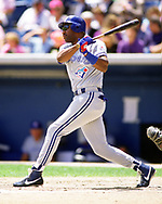 CHICAGO - 1992: Joe Carter of the Toronto Blue Jays bats during an MLB game at Comiskey Park in Chicago, Illinois during the 1992 season. (Photo by Ron Vesely) Subject:   Jesse Barfield