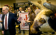 Omaha, Neb 5/6/06 Warren Buffet walks by a bull at the Justin Boots booth on the floor at the Berkshire Hathaway annual meeting in the Qwest Center Omaha Saturday Morning..(Chris Machian/Prairie Pixel Group)
