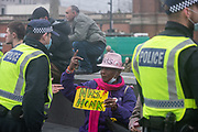 A rally organised against lockdown restrictions took place at Kings Cross Station in London, on Saturday Nov 28, 2020. Police approached some members of the public who were not wearing face masks and arrested as well as detained some of them. Police conducted foot patrol and challenged some of the members of the public who appeared to not follow the government rules as face protection and social distancing.(Photo: VXP /Erica Dezonne)