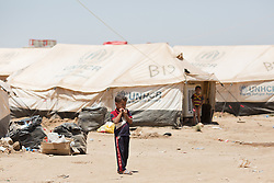 © Licensed to London News Pictures. 27/07/2014. Erbil, Iraq. Refugees from southern Iraq are seen at a camp for internally displaced persons (IDP's) at the Kalak Checkpoint near Erbil in Iraqi-Kurdistan. Photo credit: Matt Cetti-Roberts/LNP