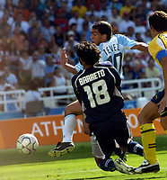 28/08/04 - ATHENS - GREECE -  - OLYMPIC FOOTBALL - FINAL MATCH - MENS  -  At the Olympic Stadium in Athens<br />ARGETNINA (1) win over PARAGUAY (0).<br />Argentine player N* 10 CARLOS TEVEZ making the goal over GK. N*18 BARRETO.<br />© Gabriel Piko / Argenpress.com / Piko-Press