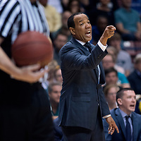 UNCW head coach Kevin Keatts reacts in the first half of the Seahawks 78-69 win over College Charleston in the CAA Men's Basketball Championship game in Charleston, S.C., Monday, March 6, 2017. (AP Photo/Mike Spencer)