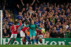 06.04.2011, Stamford Bridge, London, ENG, UEFA CL, Viertelfinale, Hinspiel, Chelsea FC (ENG) vs Manchester United (ENG), im Bild Chelsea's Fernando Torres is threatened by two Manchester United players as goalkeeper Edwin van der Sar complains during the UEFA Champions League Quarter-Final 1st leg match at Stamford Bridge, EXPA Pictures © 2011, PhotoCredit: EXPA/ Propaganda/ D. Rawcliffe *** ATTENTION *** UK OUT!