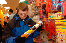 Group of men with learning disabilities shopping with carer; Bradford; Yorkshire UK