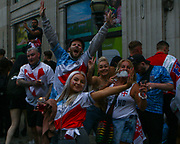Fans celebrating the first goal scored by England outside the fan zone in Trafalguar Square. 11/07/2021,  Marcin Riehs/Pathos